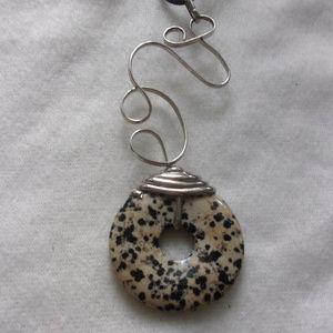 Jewelry - Art pendant with stone cirle on black cord